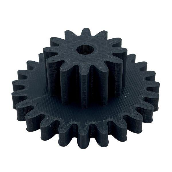Photo d'une pièce mécanique (engrenage) imprimé en 3D